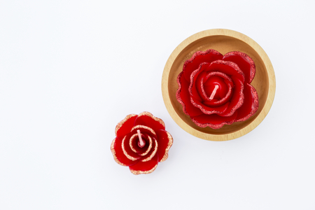 fire flower: Rose flower design in wooden bowl isolate on white background, spa aroma candle flower Stock Photo