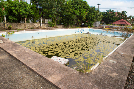 Garbage in dirty water of abandoned swimming pool Banco de Imagens