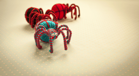 Halloween concept, colorful wool spider on vintage background