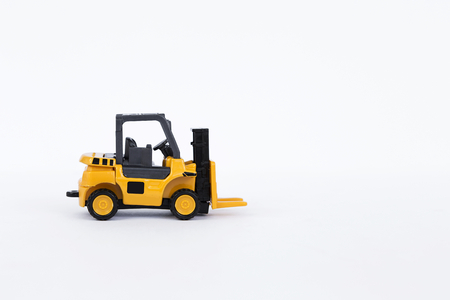 moving truck: Yellow forklift truck isolate on white background, industrial truck used to lift and move materials short distances