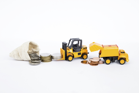 Forklift truck moving coins, business and financial concept