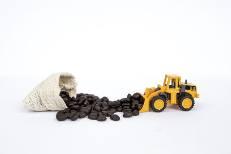 Front loader truck moving coffee bean into canvas bag Stock Photo