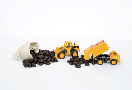 Coffee industry concept, truck moving coffee bean on white background Stock Photo