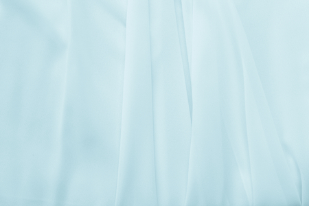 curve: Abstract pastel blue waving fabric texture background