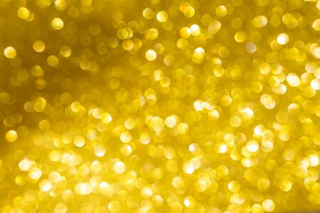 Abstract festive season concept background of bright shiny golden bokeh background