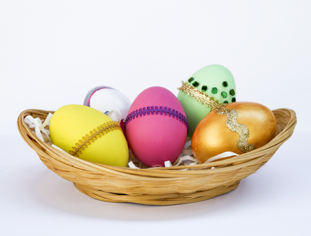 Colorful Easter egg design on bamboo basket on white background, Happy Easter concept