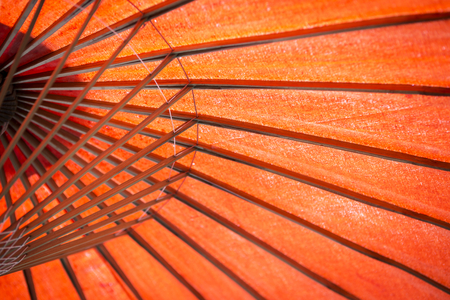 Abstract design orange color texture background, under the orange paper umbrella background