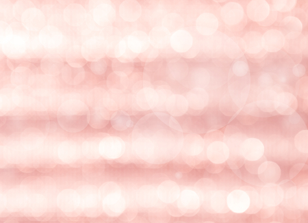 Abstract blurred light bokeh over pink background