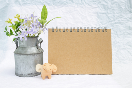 Blank Brown Card With Flower Tin Vase And Smiling Elephant Clay