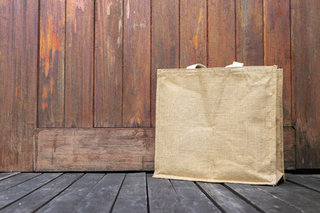 Jute shopping bag with space on wood background, outdoor day light, grocery bag Stock Photo