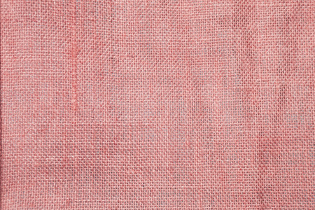 Closeup hessian fabric texture background, blank red fiber pattern background