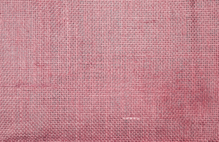 Closeup red hessian texture background, blank red fiber pattern background