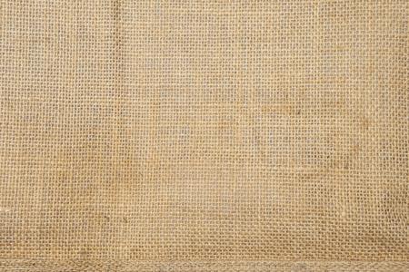 Closeup hessian fabric texture background, blank brow fiber pattern background, natural color fiber