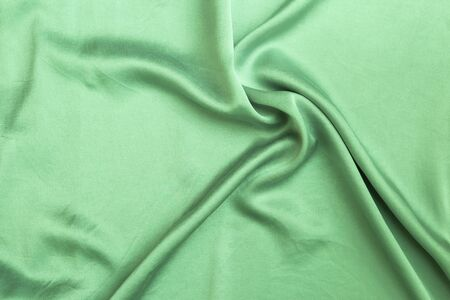 Abstract shiny green fabric texture background, blank shiny waving green fabric pattern background Stok Fotoğraf - 132458255