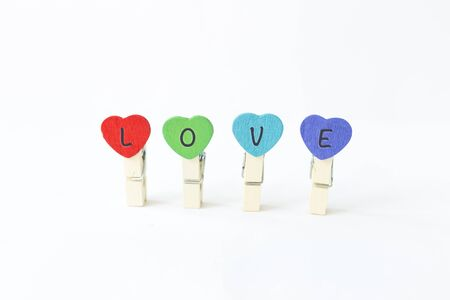 Colorful wooden heart shape clip with love message isolate on white background, valentine concept Stok Fotoğraf - 132458613