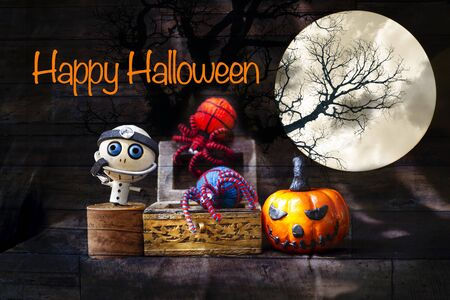 Happy Halloween concept background, wooden doctor ghost with colorful yarn spider in treasure box and halloween pumpkin over abstract vintage wood pattern background Stok Fotoğraf - 132458229