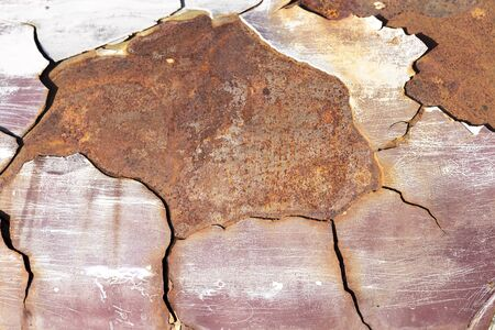 Abstract closeup old rusty steel sheet background, outdoor day light, crack on rusty old steel sheet background Stok Fotoğraf