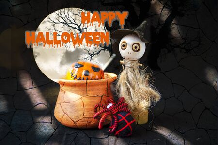 Happy Halloween concept background, Cute little wooden witch doll with black and red yarn spider with halloween pumpkin in clay pot over abstract brick wall background, decorate item