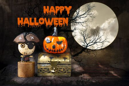 Happy Halloween concept background, cute wooden pirate ghost and smiling halloween pumpkin on treasure box over abstract brick wall pattern background, toy and decoration object Stok Fotoğraf