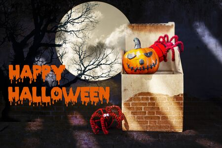 Happy Halloween concept background, smiling pumpkin with yarn spider in paper box with abstract vintage brick wall texture background, Halloween decorate item in paper box Stok Fotoğraf - 132859141