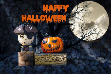 Happy Halloween concept background, wooden pirate ghost and smiling halloween pumpking in treasure box over blurred stone pattern background, halloween decoration item