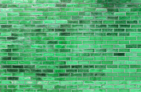 Abstract green brick wall texture background, blank brick wall patter with green filter background Banco de Imagens