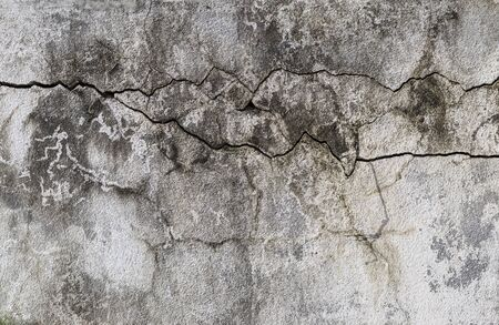 Abstract old cement wall background, crack texture on old cement wall background, construction concept, outdoor day light Banco de Imagens