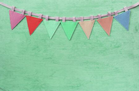 Abstract vintage fabric party flag on green texture background, celebrate and party concept background