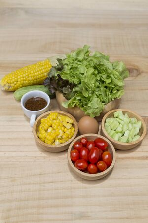Fresh vegetable in round wooden bolw, healthy food, diet food concept, fresh vegetables salad with Japanese dressing