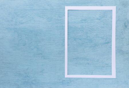 White paper frame on vintage blue texture background, blank blue pattern background