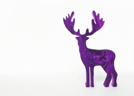 Purple wooden reindeer isolate on white background, Christmas concept