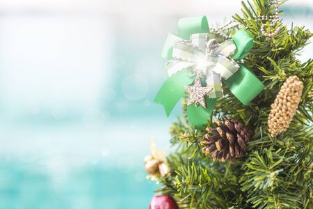 Festive season concept background, Christmas tree over blurred blue background with light bokeh