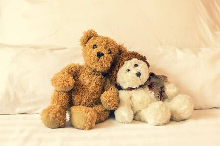 Relaxing time, two teddy bear friend sitting in the bed, vintage warm light filter, happy lovely teddy bear couple, together forever Stok Fotoğraf