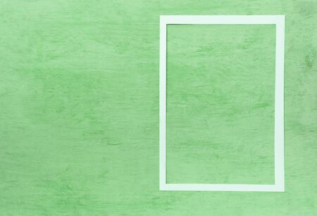Square white paper frame on green texture background