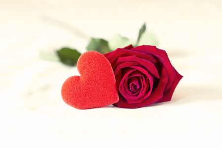 Beautiful red rose with red heart on the bed, valentine concept background, love and romance