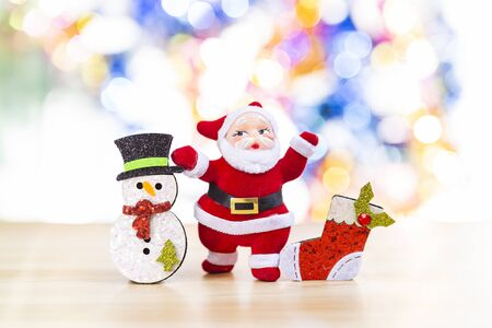 Christmas concept background, Santa with snowman and red sock over blurred colorful bokeh background, decoration item for Christmas, festive season background Stok Fotoğraf