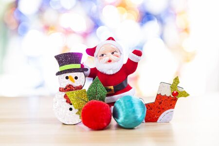 Santa with Snowman and red sock over blurred bright colorful bokeh background, Happy Christmas concept 版權商用圖片