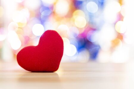 Red heart over blurred colorful bokeh