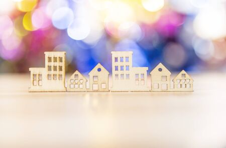 Wooden house craft over blurred colorful bokeh