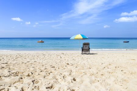 Beach in Southern Thailand, summer outdoor day light, Thailand holiday destination, colorful beach umbrella with beach chairs on the beach 版權商用圖片