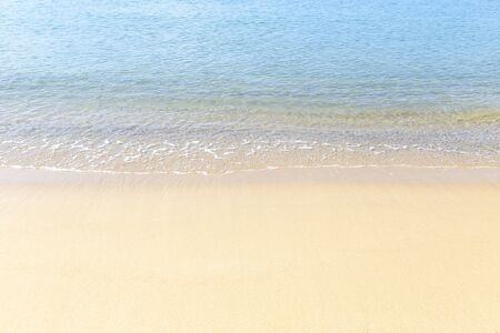 Crystal clear sea water on the clean sand beach, blue sea with empty beach, holiday and vacation backgorund