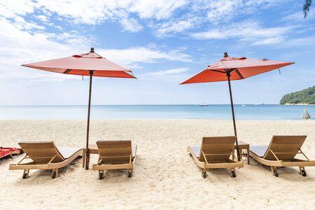 Beautiful beach, design beach chair with orange umbrella on the beach, holiday time, vacation destination, summer break