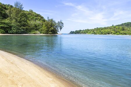 Blue sea with green island and sand beach, nature concept background, holiday and vacation destination in Southern Thailand