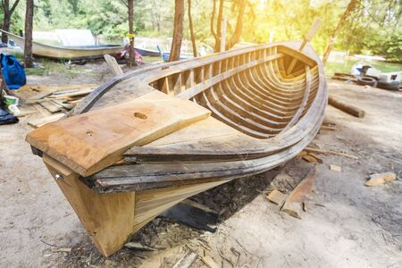 Thai wooden boat, reparing boat on the beach side, Southern Thailand, outdoor day light 版權商用圖片