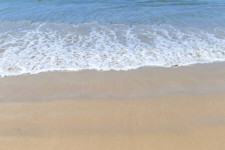 White wave on empty beach, outdoor day light, summer and holiday concept