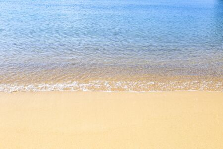 Empty clean sand beach with clear blue sea water, environmental concept, summer outdoor day light, holiday and vacation destination