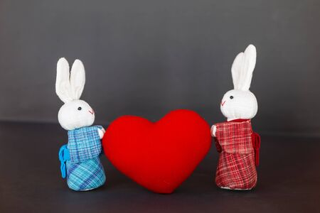 Fabric white rabbit couple in traditional Japanese dress with red heart, love and romance, valentine background concept
