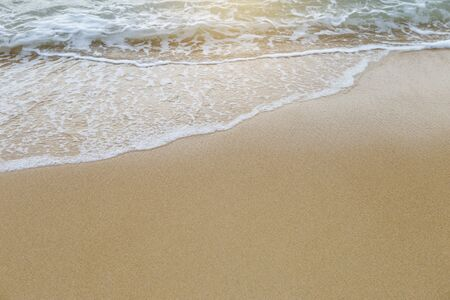 Beautiful empty sand beach background, nature texture background, outdoor day light, white wave on the fine sand beach Stok Fotoğraf