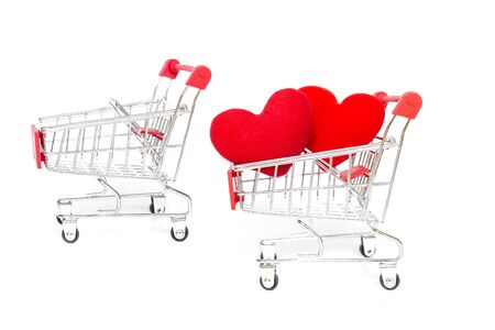 Red heart in shopping cart with empty one isolate on white background, love and romance symbol, valentine concept background Stok Fotoğraf