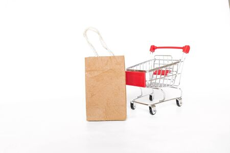 New shopping card with brown paper shopping bag isolate on white background, business object concept, no plastic bag